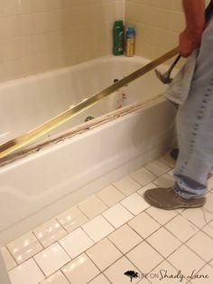 how to remove sliding shower door bottom guide